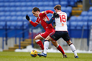 Crawley Town's Tom Nichols goes past Bolton Wanderers Andrew Tutte(18) during the EFL Sky Bet League 2 match between Bolton Wanderers and Crawley Town at the University of  Bolton Stadium, Bolton, England on 2 January 2021.