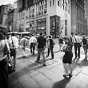 People waiting and crossing on street corners in Sydney, Australia