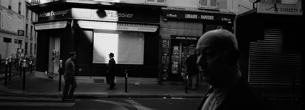 Early morning activity on the street corner of rue Juge and rue de Lourmel near Dupleix Station in Paris, France. October 13, 2007. Photo Tim Clayton..Paris is often known as 'The City of Love' but like any major City in the world, the inhabitants often live a singular existence, going about their daily lives in relative solitude. Parisians are respectful of each others space, often courteous and polite while extremely conscious of their own image. While love can be seen openly around the streets of Paris, so can the separate lives of Parisians.