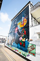 A 9 metre George Michael mural painted in Kingsbury by artist Dawn Mellor, North West London, Great Britain <br /> Unveiled 17th September 2020    <br /> <br /> A large-scale mural that celebrates the life of local hero George Michael who was a 1st year pupil at Kingsbury High School in 1974. <br /> Commissioned as part of the Brent supported by the Brent Borough of Culture 2020 fund. <br /> <br /> Photograph by Elliott Franks