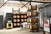Alcohol Barrel Racks Inside the Blinking Owl Distillery