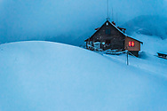 A hut in the mountain at cold winter night