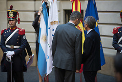 March 26, 2019 - Buenos Aires, Argentina - BUENOS AIRES, AR - 26.03.2019: KING OF SPAIN VISITS ARGENTINA - Spain King Felipe (left) and Argentine President Mauricio Macri (right) are talking as they await the arrival of businessmen for a meeting at the Palacio San Martin in Buenos Aires on Tuesday, March 26, 1919. The king Felipe and his wife, Queen Letizia, are on their first official visit to Argentina. (Credit Image: © Mario De Fina/Fotoarena via ZUMA Press)