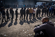 Migrants forming a line for a food distribution in Belgrade  Makeshift camp. Belgrade, Serbia. March 17th 2017. Federico Scoppa