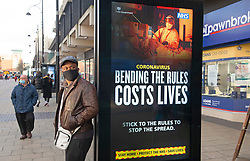 © Licensed to London News Pictures 23/01/2021.        Bexleyheath, UK. Government digital advertising in Bexleyheath Broadway, South East London warning people about the dangers of Coronavirus and how to act during this third lockdown. Photo credit:Grant Falvey/LNP