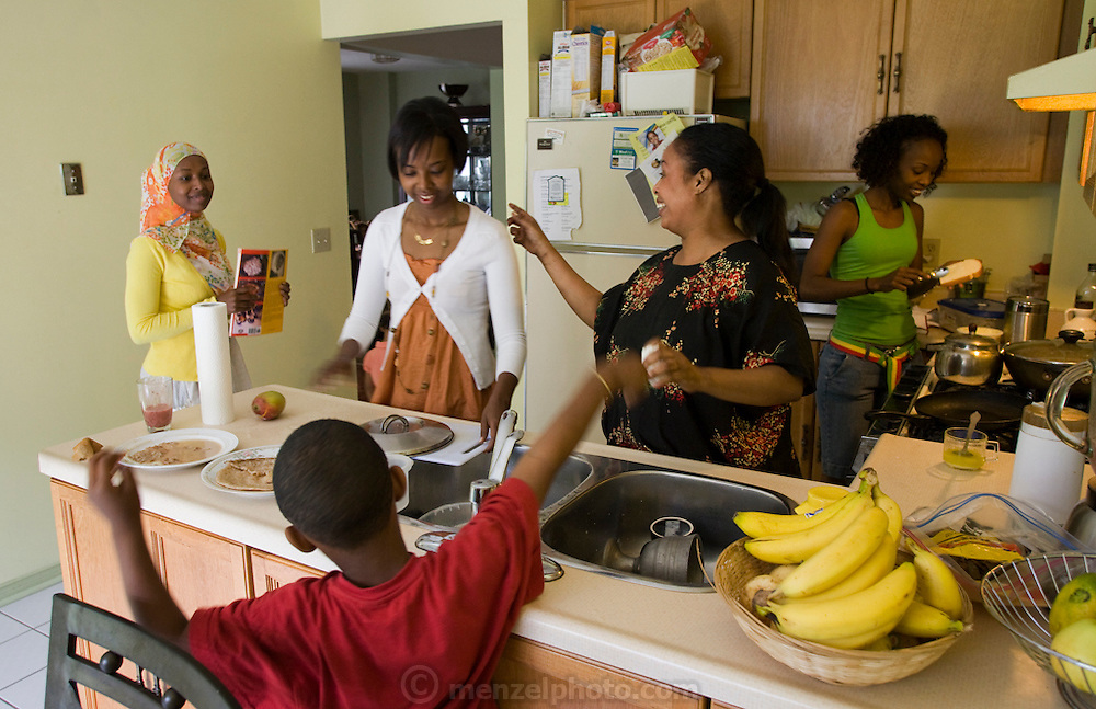 Muna Ali  (in white sweater) in her kitchen having breakfast with her family in Scarboro, Ontario, Canada. She and her family immigrated from Somalia.