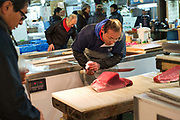The Tsukiji Fish Market, Tokyo, Japan. The largest wholesale fish and seafood market in the world. The market handles more than 400 types of seafood from tiny sardines to Tuna and Whale. More than 700,000 metric tons of seafood are handled every year with a total of some $6 billion. Some 60,000 workers are employed at the market.