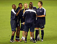 Photograph: Scott Heavey.<br />Chelsea training session in Prague before the Champions League match. 15/09/2003.<br />Jimmy Floyd Hasselbaink recieves a flicked ear from his team mates.