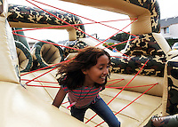 """Kids really enjoyed the gigantic inflatable """"Boot Camp"""" obstacle course at the Breadbox Recreation Center event on Saturday night in Salinas."""