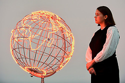 """© Licensed to London News Pictures. 11/09/2019. LONDON, UK. A staff member views """"Hot Spot"""", 2018. Preview of """"Remains to be Seen"""", a new exhibition by Mona Hatoum at White Cube gallery in Bermondsey.  This is the first presentation of her work since Tate Modern in 2016.  The show runs 12 September to 3 November 2019.  Photo credit: Stephen Chung/LNP"""