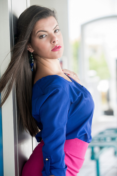 Portrait of young hispanic woman outdoors looking at camera