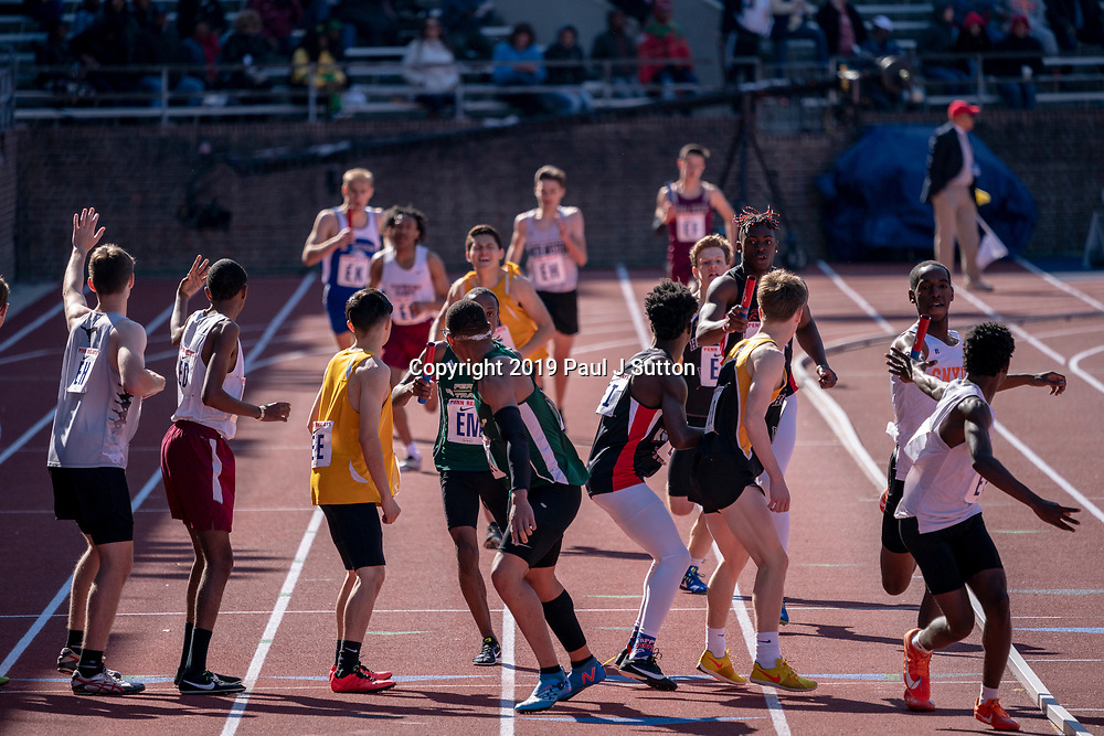 High School boys 4x400 runners competing at the 2019 Penn Relay .