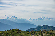 "See the Dom, Matterhorn and Weisshorn (left to right) from Riederalp ridge, in the Pennine Alps, Valais/Wallis canton, Switzerland, Europe. The Dom (4545 m / 14,911 ft) is the third highest mountain in the Alps and the second highest in Switzerland (after Monte Rosa). Located in the Pennine/Valais Alps between Randa (in Matter Valley) and Saas-Fee, the Dom is the main summit of the Mischabel Group (German: Mischabelhörner), the highest massif lying entirely in Switzerland. The Mischabel Group (ancient German term for pitchfork) includes many summits above 4000 meters: the Nadelgrat, composed of the Lenzspitze, the Nadelhorn (4327 m/14,196 ft ""Needle Peak""), Stecknadelhorn, Hohberghorn and Dürrenhorn; and Täschhorn (4491 m south/just left of highest peak in photo), plus the flat summit of the Alphubel (4206 m / 13,799 ft, further left). From Fiesch, lift to Fiesheralp, then hike to vast views of Aletsch Glacier via Hohbalm, Moosfluh, Hohfluh, Riderfurke, and Riederalp."