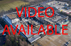VIDEO AVAILABLE https://we.tl/t-vAqa8XRdif  © Licensed to London News Pictures. 12/02/2019. Andover, UK. As the ruins still smoulder aerial photographs show the fire damage and the remains of the Ocado warehouse in Andover after the fire was mostly extinguished. The fire raged for three days starting a week ago with 300 fire fighters tackling the blaze at the giant robotic warehouse.  Photo credit: Peter Macdiarmid/LNP