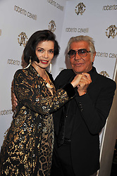 BIANCA JAGGER and ROBERTO CAVALLI at a party hosted by Roberto Cavalli to celebrate his new Boutique's opening at 22 Sloane Street, London followed by a party at Battersea Power Station, London SW8 on 17th September 2011.