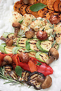 A plate of Italian style Antipasti with Courgette, Mushroom, Sweet Potato, Aubergine, Onion and Garlic