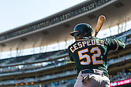 Yoenis Cespedes #52 of the Oakland Athletics waits on-deck during a game against the Minnesota Twins on April 9, 2014 at Target Field in Minneapolis, Minnesota.  The Athletics defeated the Twins 7 to 4.  Photo by Ben Krause