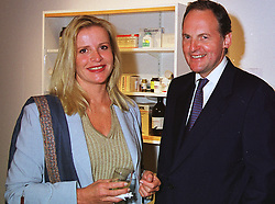 MISS EUGENIA GRANDCHAMP DES RAUX and the EARL OF DARTMOUTH at a party in London on 22nd June 1999.MTP 10 2olo
