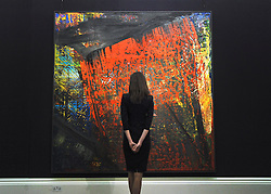 © Licensed to London News Pictures. 07/10/2011. LONDON. UK. A Sotheby's worker looks at Gudrun (633) by Gerhard Richter at a Sotheby's Preview.  The piece, one of 5 will be sold at auction in October 2011 and is expected to fetch $5.5/6.5million. Photo credit:  Stephen Simpson/LNP