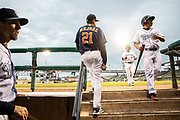 Sig Mejdal, a sabermetrics analyst for the Houston Astros, watches the action from the top of the dugout steps during a Corpus Christi Hooks game against the Midland Rockhounds Wednesday April 25th at Whataburger Field in Corpus Christi, TX. The Hooks are a minor league affiliate of the Houston Astros.