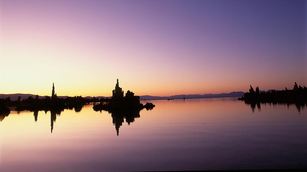Dawn glow on Mono Lake, California, with tufa towers reflections