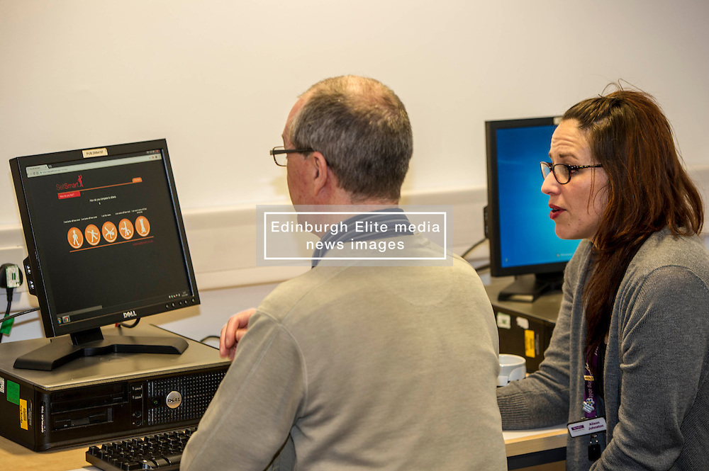Pictured: Alison Johnston shows Brian Hutchison the ropes<br /> <br /> Today, Minister for employability and training, Jamie Hepburn MSP visited Remploy in Edinburgh where he announced new employment services funding. Mr Hepburn gave details on cash which will develop new ways of supporting the Scottish Government's new devolved employment services. <br /> <br /> Ger Harley   EEm 21 December 2016
