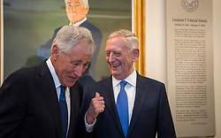May 19, 2017 - Arlington, United States - U.S. Secretary of Defense Jim Mattis, right, and former Secretary of Defense Chuck Hagel share a laugh during the unveiling ceremony for Hagel's official portrait at the Pentagon May 19, 2017 in Arlington, Virginia. Hagel served as the 24th Secretary of Defense from February 2013 to February 2015. (Credit Image: © Brigitte N. Brantley/Planet Pix via ZUMA Wire)