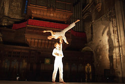 "© Licensed to London News Pictures. 24 June 2013. London, England. Pictured: Paul O'Keeffe (top) and Gerramy Marsden perform an acrobatics act. Circa and I Fagiolini present ""How Like An Angel"", a ""Beyond Barbican"" production as part of the City of London Festival, in the church of St Batholomew the Great, West Smithfield, London. Photo credit: Bettina Strenske/LNP"