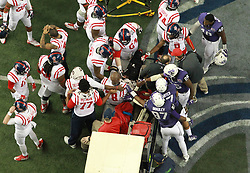 Dec 31, 2014; Atlanta , GA, USA;  Mississippi Rebels players an TCU Horned Frogs players reacts to Mississippi Rebels offensive lineman Laremy Tunsil (78) after he broke his leg during the second quarter in the 2014 Peach Bowl at the Georgia Dome. Mandatory Credit: Kevin Liles/CFA Peach Bowl via USA TODAY Sports