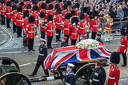 © licensed to London News Pictures. London, UK 17/04/2013. The funeral procession of former British Prime Minister Margaret Thatcher passing along Fleet Street on its way to St Paul's Cathedral from Westminster Abbey. The coffin is being carried on a Gun Carriage drawn by the King's Troop Royal Artillery along a processional route lined by around 700 members of the three armed forces. Photo credit: Tolga Akmen/LNP