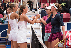 Arantxa Rus (Netherlands, left) and Quirine Lemoine (Netherlands) shaking hands with María Irigoyen (Argentina) and Barbora Krejcikova (Czech Republic) after the doubles final at the 2017 WTA Ericsson Open in Båstad, Sweden, July 30, 2017. Photo Credit: Katja Boll/EVENTMEDIA.