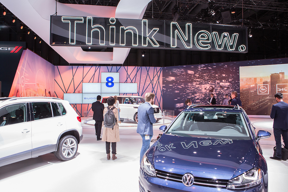 """New York, NY, USA-23 March 2016. VW's """"Think New"""" sign seemed to apply to it's concept car, dubbed the Budd-e, a connected vehicle with a number of """"smart"""" personalizable options, many of which are entertainment-centered."""