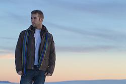man at dusk outdoors