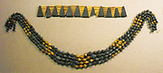 Mesopotamian jewellery excavated at Ur. (Bottom); Necklace beads  Early Dynastic IIIa, ca. 2600–2500 B.C. In Gold, lapis lazuli. These four strands of beads come from the so-called Great Death Pit, one of the royal graves at Ur. Necklace. (Top); Collar consisting of alternating triangles, twelve of lapis lazuli and eleven of gold. ca. 2600–2500 B.C