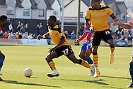 Newport's David Tutonda © scores his sides first goal after bursting past the Dagenham defence into the box. Skybet football league two match , Newport county v Dagenham & Redbridge at Rodney Parade in Newport, South Wales on Saturday 18th April 2015.<br /> pic by David Richards, Andrew Orchard sports photography.