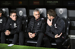 Manchester United manager Jose Mourinho (centre) speaks with Coach Michael Carrick (right)