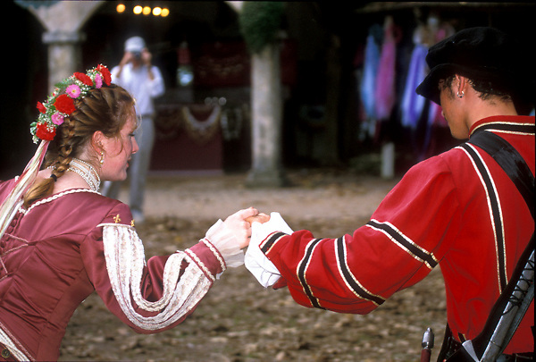 Stock photo of a man and woman in costume holding hands at the Texas Renaissance Festival in Plantersville Texas
