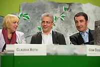27 APR 2013, BERLIN/GERMANY:<br /> Claudia Roth (L), B90/Gruene Bundesvorsitzende, Tarek Al-Wazir (M), B90/Gruene, Landesvorsitzender Hessen und Spitzenkandidat fuer die Landtagswahl, und Cem Oezdemir (R), B90/Gruene Bundesvorsitzender, Bundesdelegiertenkonferenz Buendnis 90 / Die Gruenen, Velodrom<br /> IMAGE: 20130427-01-164<br /> KEYWORDS: Parteitag, Bundesparteitag, BDK, party congress, Bündnis 90 / Die Grünen, B90/Gruene, B90/Grüne, Cem Özdemir