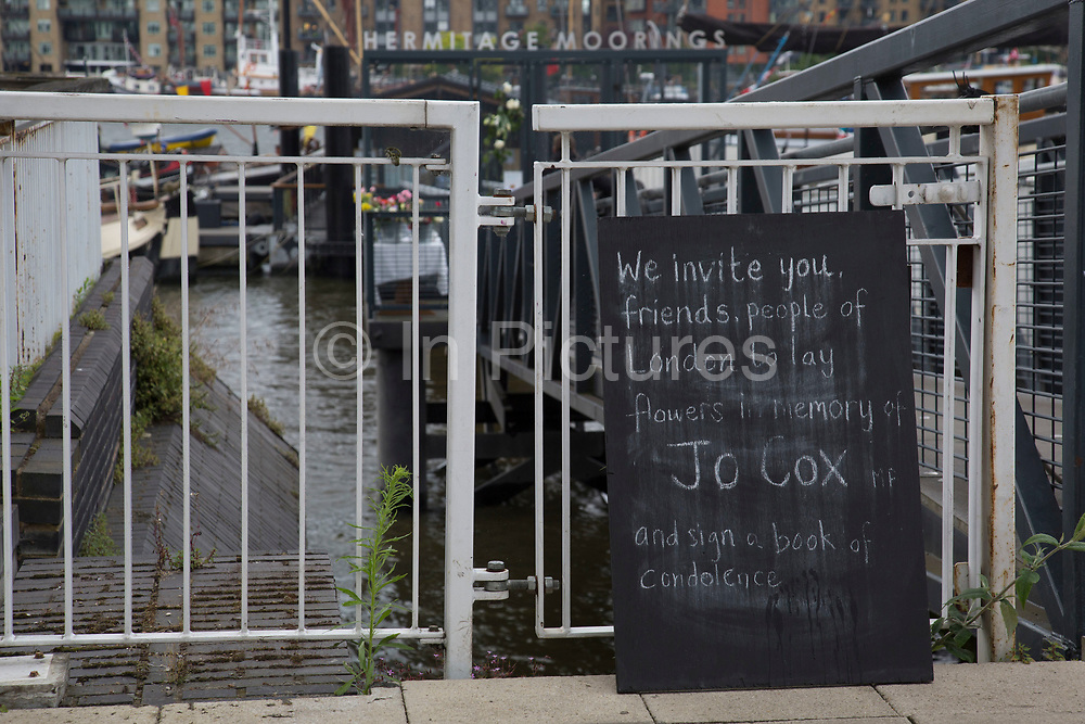 Memorial for Jo Cox MP at her home in Wapping which was on a houseboat at Hermitage Moorings in London, England, United Kingdom. Helen Joanne Jo Cox was a British Labour Party politician. She was the Member of Parliament MP for the Batley and Spen constituency from her election in May 2015 until her death 13 months later in June 2016, having won the seat with an increased majority for Labour in the 2015 general election. On 16 June 2016, Cox died shortly after being shot and stabbed multiple times in Birstall, where she had been due to hold a constituency surgery.