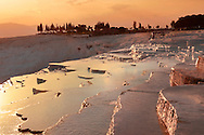 Photo & Image  of Pamukkale Travetine Terrace, Turkey, at sunset. Images of the white Calcium carbonate rock formations. Buy as stock photos or as photo art prints. 4 Pamukkale travetine terrace water cascades, composed of white Calcium carbonate rock formations, Pamukkale, Anatolia, Turkey .<br /> <br /> If you prefer to buy from our ALAMY PHOTO LIBRARY  Collection visit : https://www.alamy.com/portfolio/paul-williams-funkystock/pamukkale-hierapolis-turkey.html<br /> <br /> Visit our TURKEY PHOTO COLLECTIONS for more photos to download or buy as wall art prints https://funkystock.photoshelter.com/gallery-collection/3f-Pictures-of-Turkey-Turkey-Photos-Images-Fotos/C0000U.hJWkZxAbg