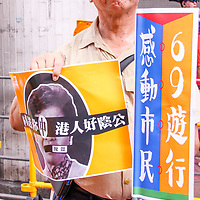 A protester exhibits his sign during June protests in Hong Kong. Protesters are opposed to a controversial extradition bill.