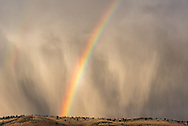 A double rainbow amidst a storm in Eastern Oregon