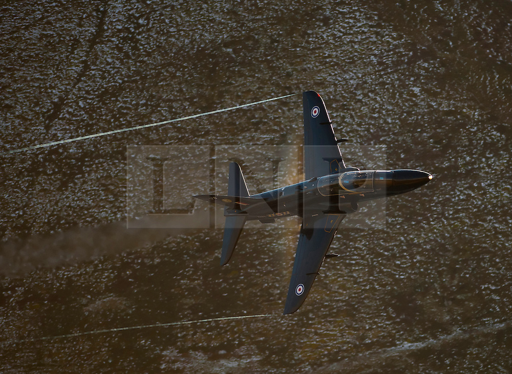 © London News Pictures. 14_02_2011. The RAF is to cut back on a quarter of its trainee pilots as a result of defence cuts. File Picture: Students fly the Hawk which first entered service with the RAF in 1976, both as an advanced flying-training aircraft and a weapons-training aircraft. The Hawk T1 version is currently used at RAF Valley for fast-jet pilot advanced flying training. In its weapons and tactical training role the Hawk is used to teach air combat, air-to-air firing, air-to-ground firing and low-flying techniques and operational procedures. Picture credit should read Andrew Chittock/LNP