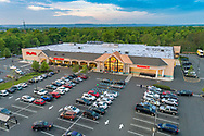 Aerial photography of commercial shopping center in NJ taken at dusk