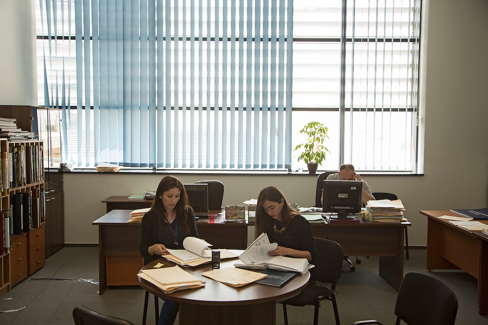 Two women (RELEASED, names on form) work inside the Palace of Justice in Pristina, Kosovo.<br /> <br /> Matt Lutton for the European Commission