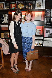 Left to right, LAURA JACKSON and ALICE LEVINE at the launch of new book 'Farfetch Curates: Food' at Maison Assouline, Piccadilly, London on 24th March 2015.