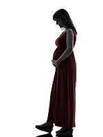 one  pregnant woman full length in silhouette studio on white background