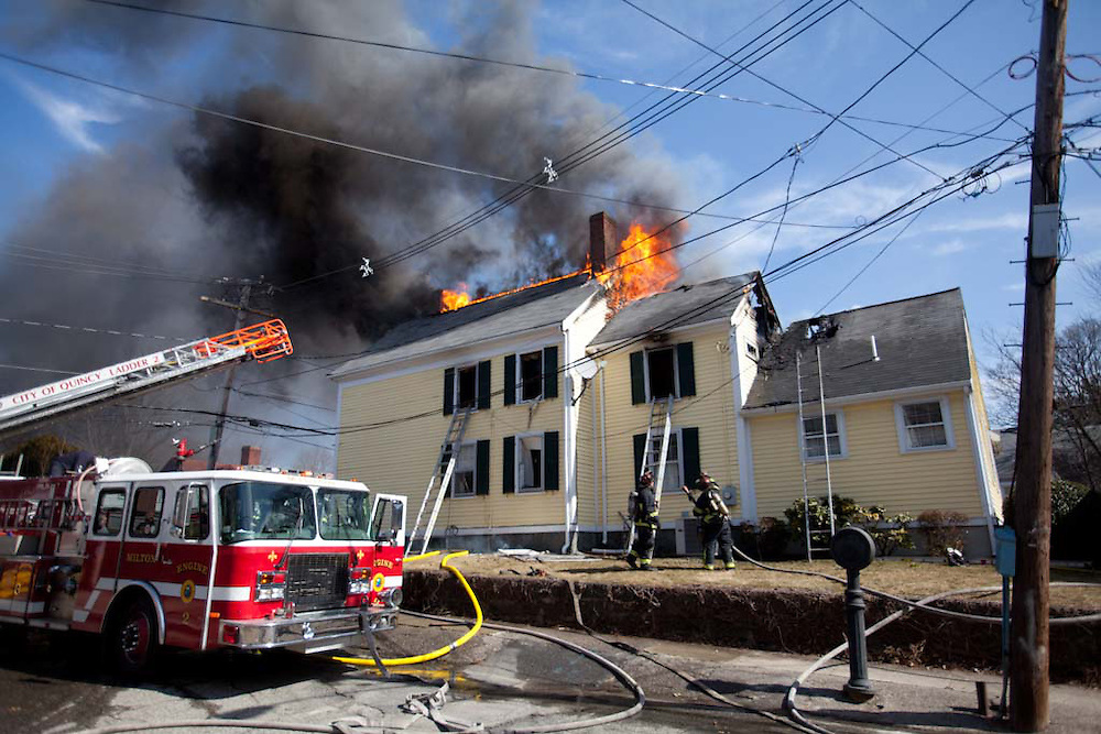 Milton, MA 03/08/2012<br /> Companies respond to a 3 alarm house fire at 589 Adams St. in Milton on Thursday afternoon.