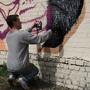 London,England,UK : 10th April 2016 : Will Vibes street artists paint a live Tiger for the 'Endangered 13' at Ackroyd Drive Sponsor by Tower Hamlets council in London. Photo by See Li