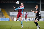 Scunthorpe United Ryan Loft (9) controls the ball during the EFL Sky Bet League 2 match between Scunthorpe United and Grimsby Town FC at the Sands Venue Stadium, Scunthorpe, England on 23 January 2021.